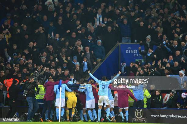 Manchester City players celebrate penalty shoot out victory during the Carabao Cup QuarterFinal match between Leicester City and Manchester City at...
