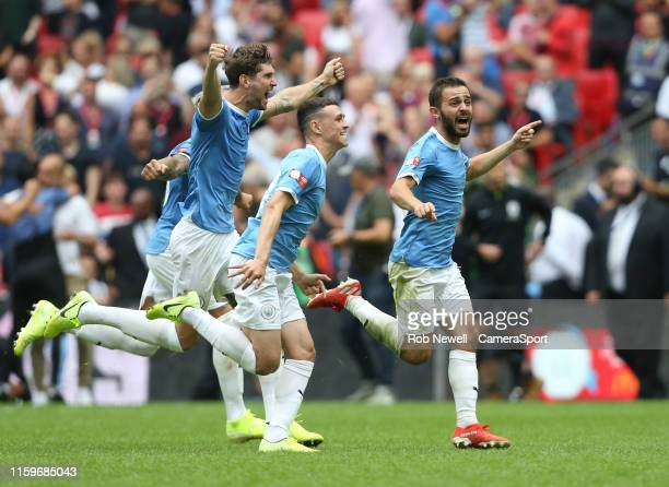 Manchester City players celebrate their penalty shootout win during the The FA Community Shield match between Liverpool and Manchester City at...