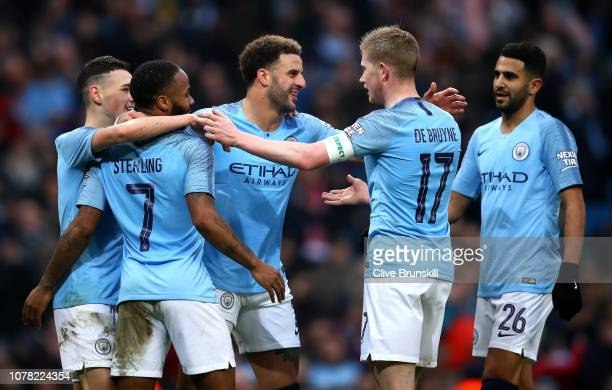 Manchester City players celebrate their team's third goal during the FA Cup Third Round match between Manchester City and Rotherham United at the...