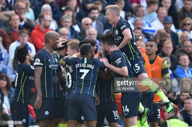 Manchester City players celebrate their third goal during the English Premier League football match between Brighton and Hove Albion and Manchester...