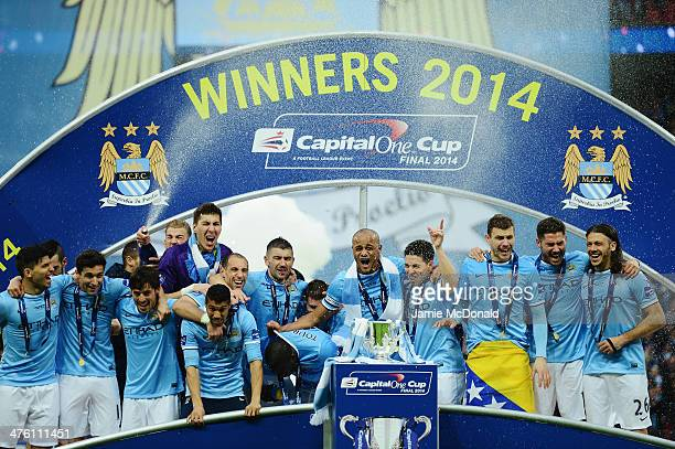 Manchester City players celebrate victory after the Capital One Cup Final between Manchester City and Sunderland at Wembley Stadium on March 2 2014...