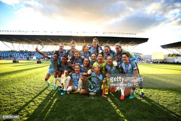 Manchester City players celebrate winning the FA WSL Continental Tyres Cup Final