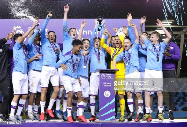 Manchester City players celebrate winning the Premier League Cup after the Under 18's Premier League 2 Cup Final at The Academy Stadium on March 10...