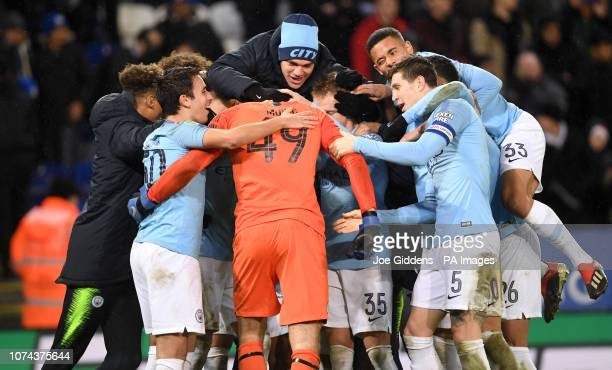Manchester City players celebrate with goalkeeper Arijanet Muric as they win 31 in the penalty shoot out during the Carabao Cup Quarter Final match...