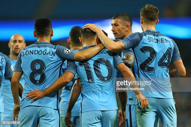 Manchester City players celebrate with goalscorer Sergio Aguero during the UEFA Champions League match between Manchester City FC and VfL Borussia...
