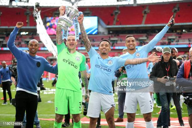 Manchester City players celebrate with the FA Cup Trophy following the FA Cup Final match between Manchester City and Watford at Wembley Stadium on...