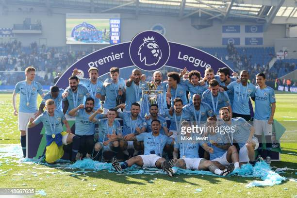 Manchester City players celebrate with the Premier League Trophy after winning the title during the Premier League match between Brighton & Hove...