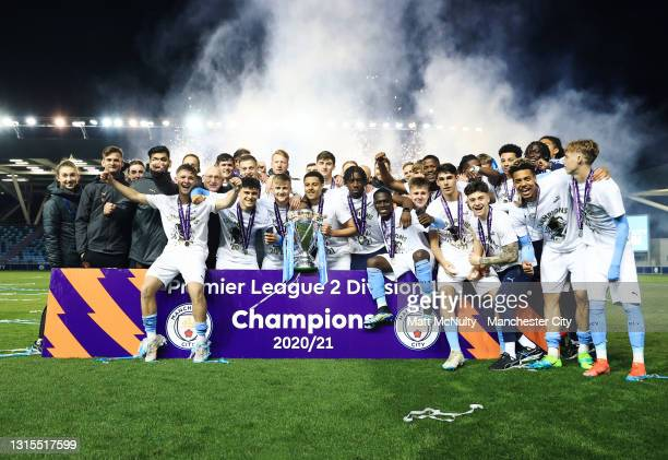Manchester City players celebrate with the Premier League trophy following the Premier League 2 match between Manchester City and Tottenham Hotspur...
