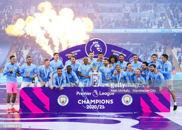 Manchester City players celebrate with the Premier League trophy during the Premier League match between Manchester City and Everton at Etihad...