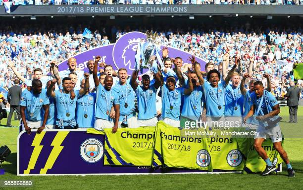 Manchester City players celebrate with the Premier League trophy after the Premier League match between Manchester City and Huddersfield Town at...