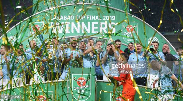 Manchester City players celebrate with the trophy after winning the Carabao Cup Final between Chelsea and Manchester City at Wembley Stadium on...