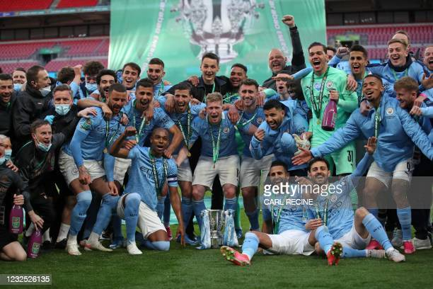 Manchester City players celebrate with the trophy after winning the English League Cup final football match between Manchester City and Tottenham...
