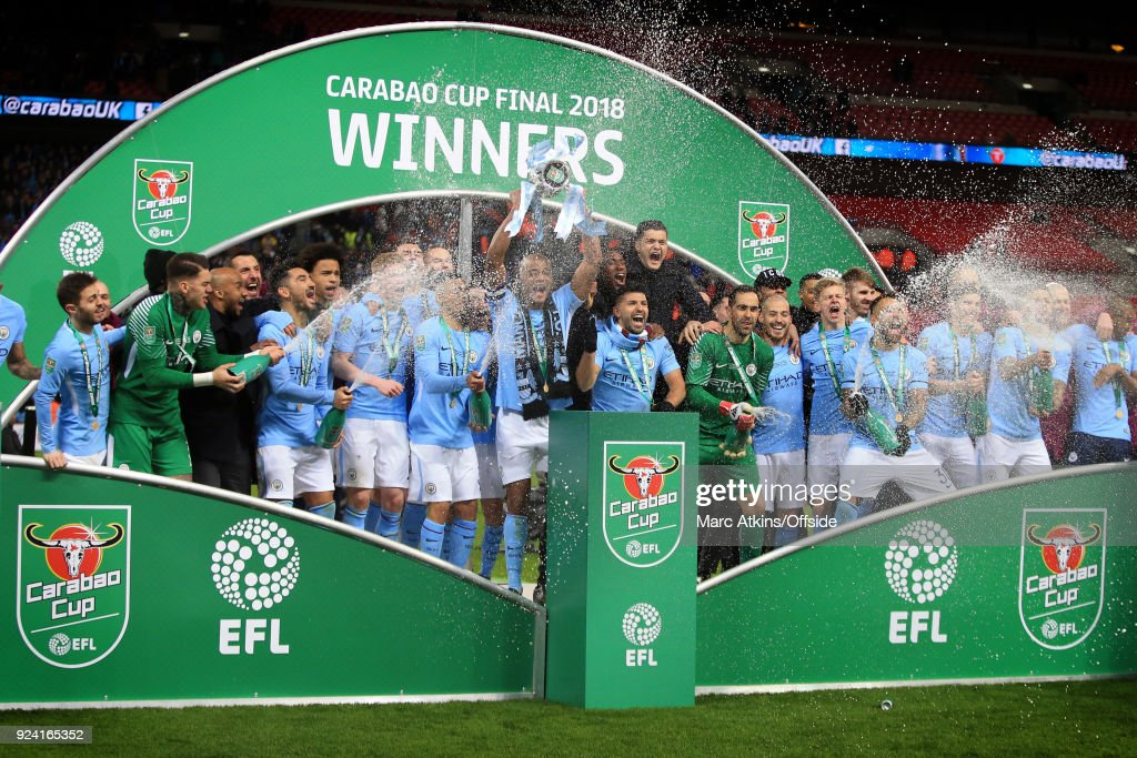 Manchester City players celebrate with the trophy during the Carabao Cup Final between Arsenal and Manchester City at Wembley Stadium on February 25, 2018 in London, England.