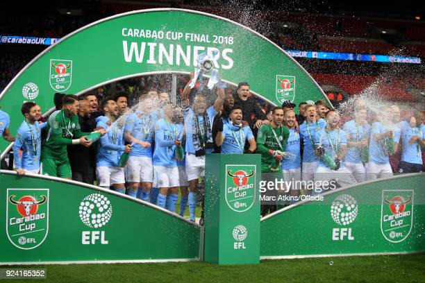 Manchester City players celebrate with the trophy during the Carabao Cup Final between Arsenal and Manchester City at Wembley Stadium on February 25...