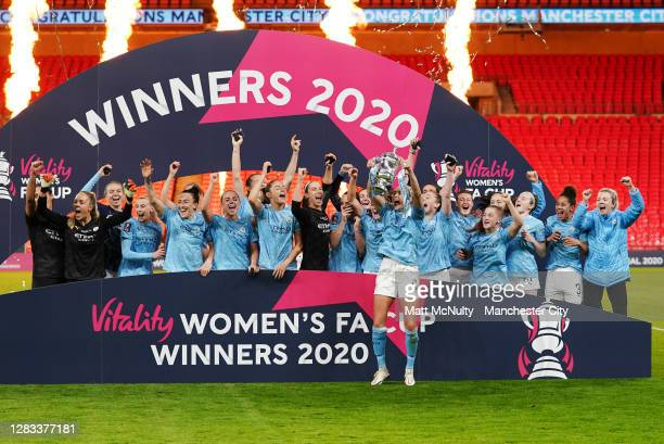 Manchester City players celebrate with the trophy during the Vitality Women's FA Cup Final match between Everton Women and Manchester City Women at...