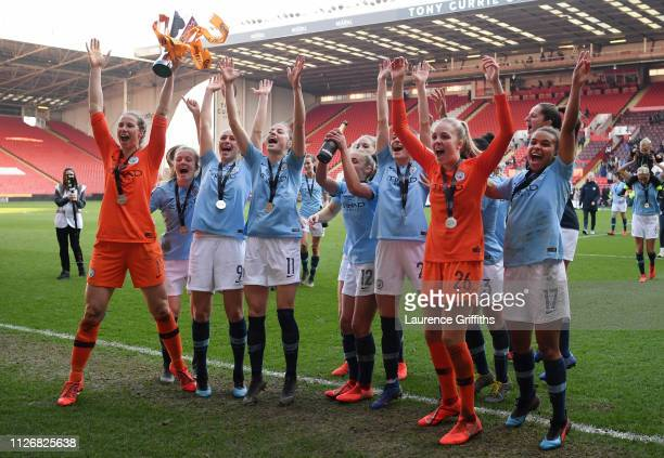 Manchester City players celebrate with the trophy following the FA Women's Continental League Cup Final between Arsenal and Manchester City Women at...