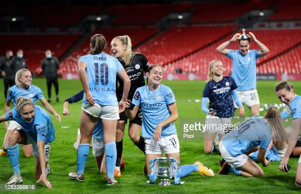 Manchester City players celebrate with the Vitality Women's FA Cup Trophy following their team's victory in the Vitality Women's FA Cup Final match...