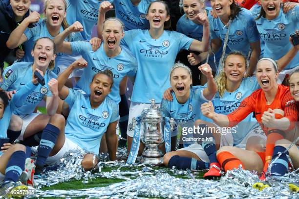 Manchester City players celebrate with the Women's FA Cup Trophy following their team's victory in the Women's FA Cup Final match between Manchester...