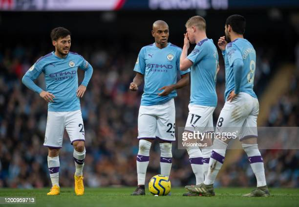 Manchester City players David Silva, Fernandinho, Kevin De Bruyne and Ilkay Gundogan discuss a free kick during the Premier League match between...