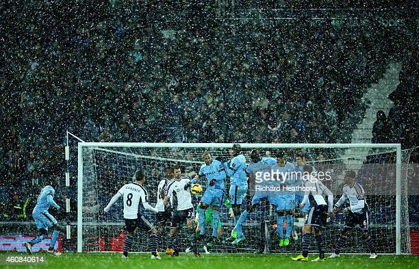 Manchester City players defend a freekick taken by Craig Gardner of West Brom during the Barclays Premier League match between West Bromwich Albion...