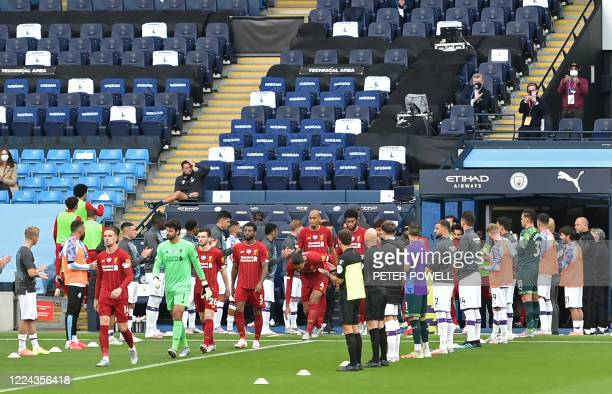 Manchester City players form a guard of honour for the Liverpool players as they make their way onto the pitch after capturing the league title last...