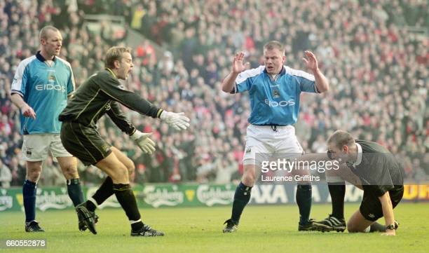 Manchester City players from left to right Spencer Prior Nicky Weaver and Andy Morrison react as referee Graham Poll dramatically awards a penalty to...