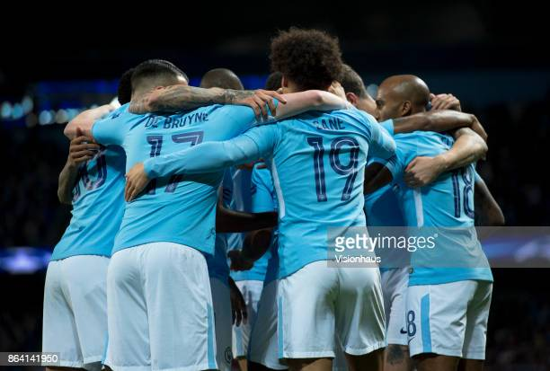 Manchester City players huddle after Raheem Sterling scores during the UEFA Champions League group F match between Manchester City and SSC Napoli at...
