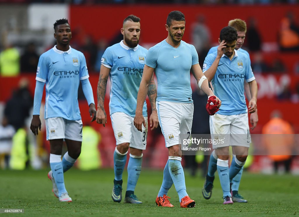 Manchester City players leave the pitch after the 0-0 draw in the Barclays Premier League match between Manchester United and Manchester City at Old Trafford on October 25, 2015 in Manchester, England.