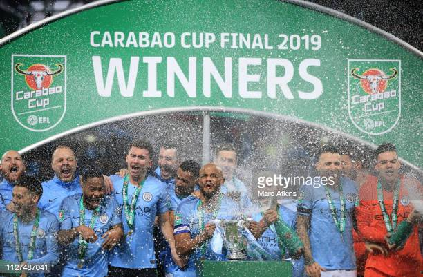 Manchester City players led by Vincent Kompany of celebrate with the trophy during the Carabao Cup Final between Chelsea and Manchester City at...