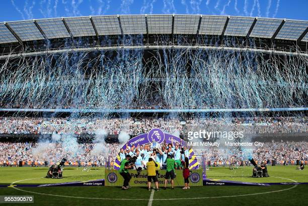 Manchester City players lift the Premier League trophy as Champions after the Premier League match between Manchester City and Huddersfield Town at...