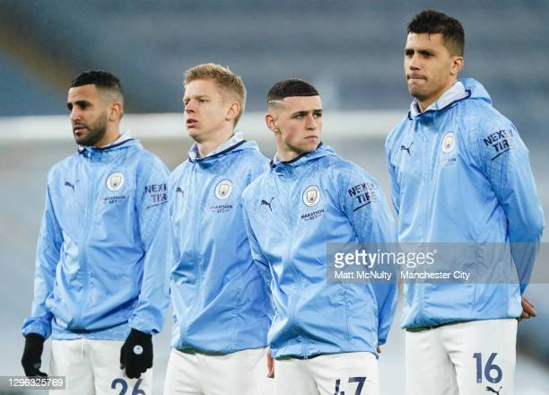 Manchester City players line up during the Premier League match between Manchester City and Brighton & Hove Albion at Etihad Stadium on January 13,...