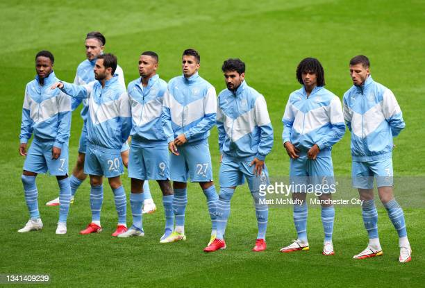 Manchester City players line up in warm up jackets during the Premier League match between Manchester City and Southampton at Etihad Stadium on...