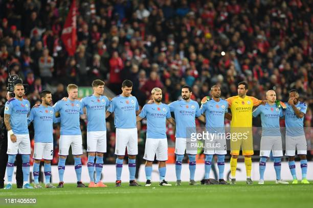 Manchester City players line up to pay their respects for Remembrance Day ahead of the English Premier League football match between Liverpool and...