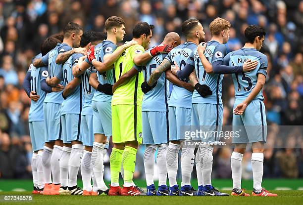 Manchester City players observe a minutes silence for the victims of the plane crash involving the Brazilian club Chapecoense prior to the Premier...