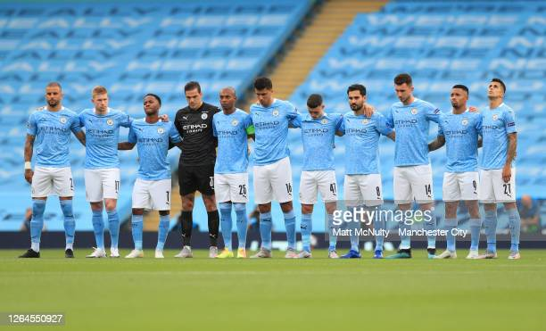 Manchester City players observe a minutes silence in respect for those who have lost their lives to COVID-19 prior to the UEFA Champions League round...