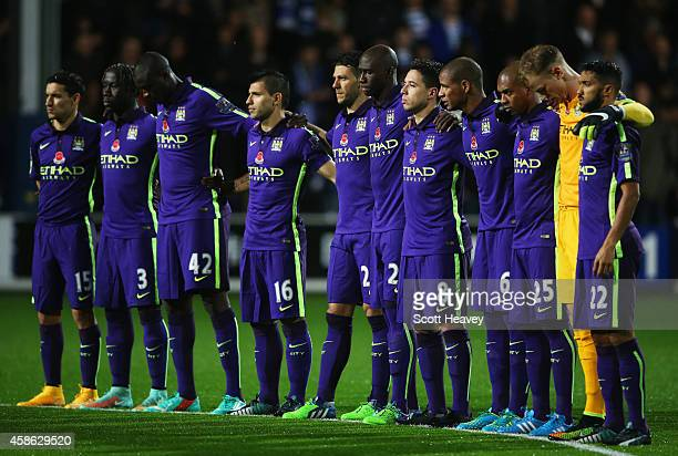 Manchester City players observe a Remembrance Day silence prior to the Barclays Premier League match between Queens Park Rangers and Manchester City...