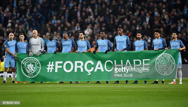 Manchester City players pause for a one minute silence in honour of the victims of a plane crash, which was carrying aboard it members of the...