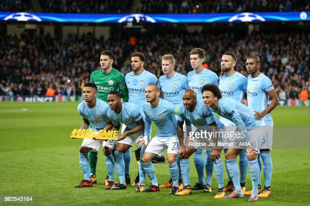 Manchester City players pose for a team photo holding a message which reads Equal Game prior to the UEFA Champions League group F match between...