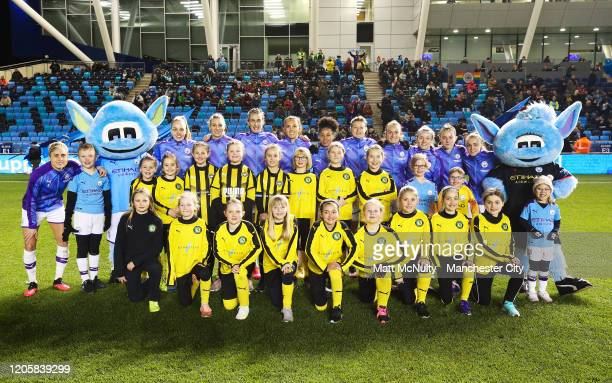 Manchester City players pose for a team photo with mascots prior to the Barclays FA Women's Super League match between Manchester City and Bristol...
