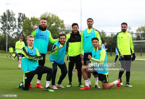 Manchester City players pose for a winning team photo during the training session at Manchester City Football Academy on May 03 2019 in Manchester...