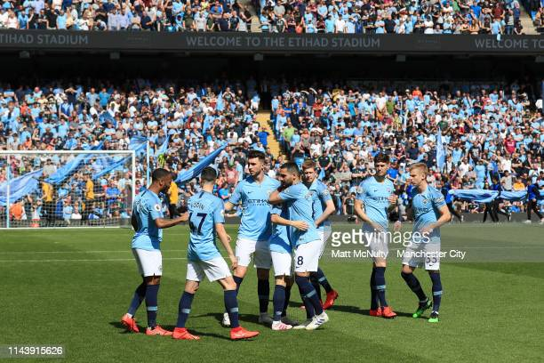 Manchester City players prepare for kick off prior to the Premier League match between Manchester City and Tottenham Hotspur at Etihad Stadium on...