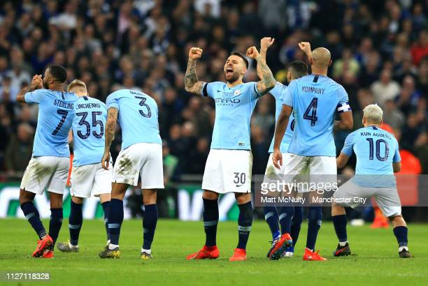 Manchester City players react during the penalty shootout in the Carabao Cup Final between Chelsea and Manchester City at Wembley Stadium on February...