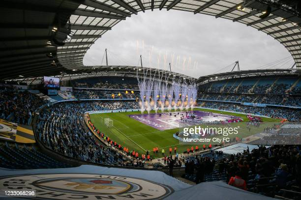 Manchester City players recieve the Premier League trophy after the Premier League match between Manchester City and Everton at Etihad Stadium on May...