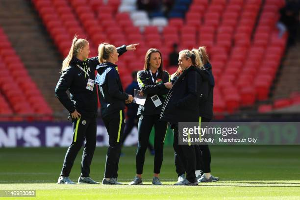 Manchester City players speak during a pitch inspection prior to the Women's FA Cup Final match between Manchester City Women and West Ham United...