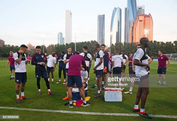 Manchester City players take a break during the training session on March 16 2018 in Abu Dhabi United Arab Emirates