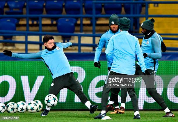 Manchester City players take part in a training session in Kharkiv on December 5 on the eve of the UEFA Champion League football match between...