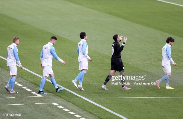 Manchester City players walk to the pitch during the FA Cup Semi Final match between Arsenal and Manchester City at Wembley Stadium on July 18 2020...