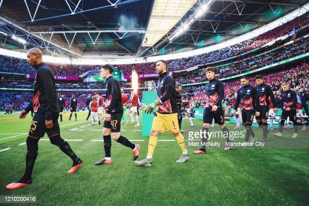Manchester City players walk to the pitch prior to the Carabao Cup Final between Aston Villa and Manchester City at Wembley Stadium on March 01 2020...