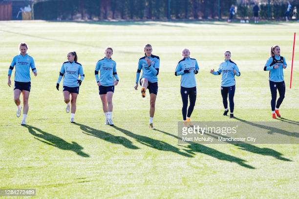 Manchester City players warm up during a training session at Manchester City Football Academy on November 06, 2020 in Manchester, England.