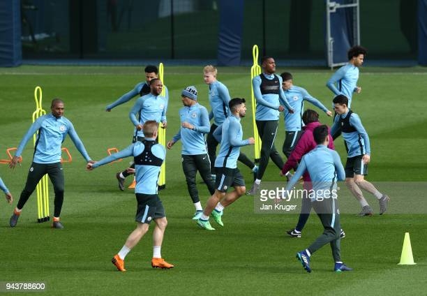 Manchester City players warm up during a training session at Manchester City Football Academy on April 9 2018 in Manchester England